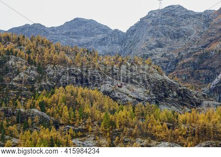 Zermatt, Switzerland-october 21, 2019:view Of The Rock Mountain On Furi Cable Car Station In Autumn