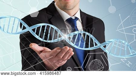 Dna structure and chemical structures over mid section of business man with cupped hand. global business and medical research technology concept