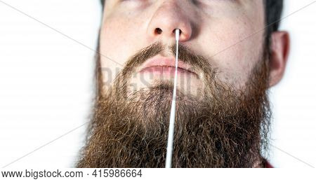 Covid-19 Nasal Swab Test, Taking Nasal Mucus Test Sample, Cotton Swab From The Throat And Nose Isola