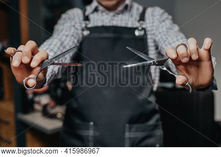 Barber Holding Scissors. Barbershop Equipment. Close-up Hairdresser Tools. Selective Focus