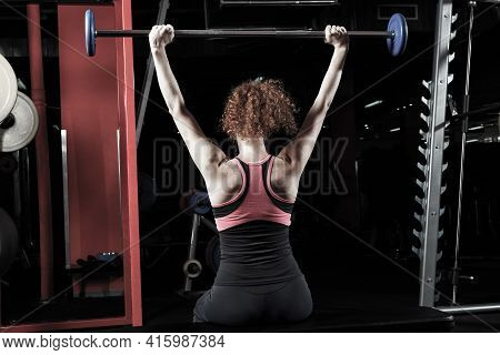Woman Bodybuilder Engaged With A Barbell In The Gym. Healthy Lifestyle.