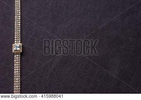 Womens Jewelry Bracelet. Precious Bangle Jewelry On Gray Background With Copy Space