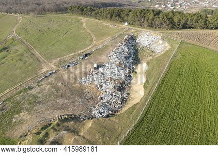 A City Dump Landfill Located Near The Arable Area. Aerial Top View Of A Huge Waste, Garbage, Dump La