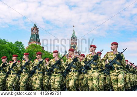 Victory Parade On Red Square In Moscow. The Russian Army In Red Berets And Green Uniforms. Military