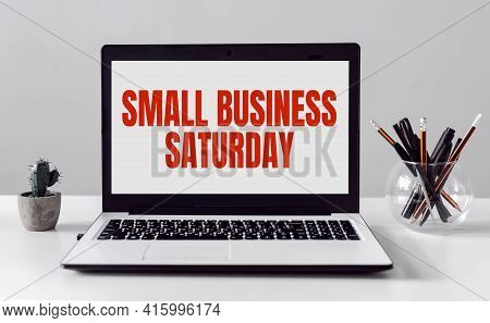 Laptop With Small Business Saturday Text On Modern Office Background.