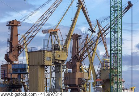 Composition Of Industrial Massive Cranes In The Shipyard In Gdansk, Poland.