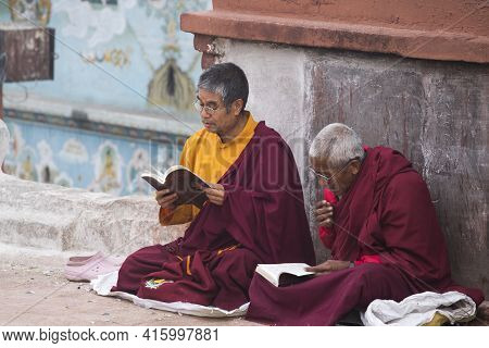 Nepal, Kathmandu, April 21: Unidentified Monks Praying At The Famous Bouddanath Temple In Kathmandu,