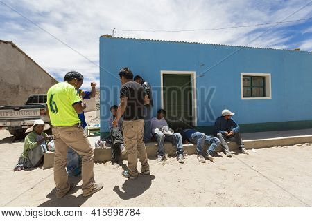 Rosario, Bolivia, Jan 1: Group Of Group Of Bolivian Men Drinking Alcohol In The Street During Sunday