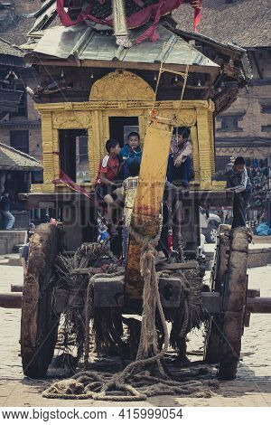 Bhaktapur, Nepal, April 24: Unidentified Group Of Kids Playing On A Very Strange Transport Dedicated