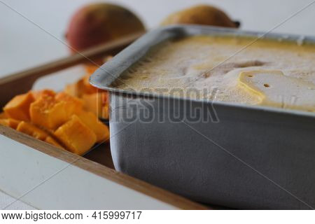 Home Made Mango Ice Cream Prepared Using Lalbagh Mangoes. Kept Outside From Freezer In An Aluminium
