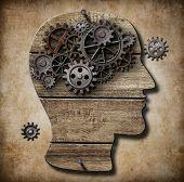 Human brain work metaphor made of rusty metal gears poster