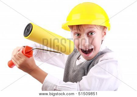 Beautiful funny blond boy wearing a yellow hard hat painting with a painting roller looking crazy