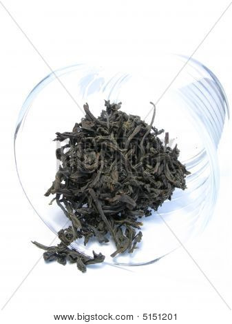 the food portion of black tea in a transparent glass. poster