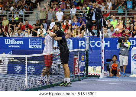 KUALA LUMPUR - SEPTEMBER 28: Joao Sousa (black) hugs Jurgen Melzer after winning this semi-final match of the Malaysia Open 2013 tennis played at the Putra Stadium, Malaysia on September 28, 2013.