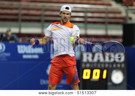 KUALA LUMPUR - SEPTEMBER 28: Jurgen Melzer drives a return to Joao Sousa in a semi-final match of the Malaysia Open 2013 tennis played at the Putra Stadium, Malaysia on September 28, 2013.