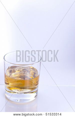 Tumbler With Brown Alcohol On White Background