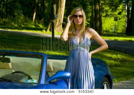 Model Posing With A Car
