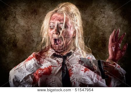 Dead Female Zombie With Saw And Amputated Hand