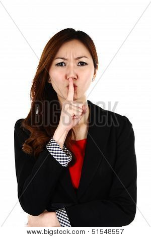 Portrait Of Young Asian Business Woman Keeping Finger On Her Lips And Asking To Keep Quiet, Isolated