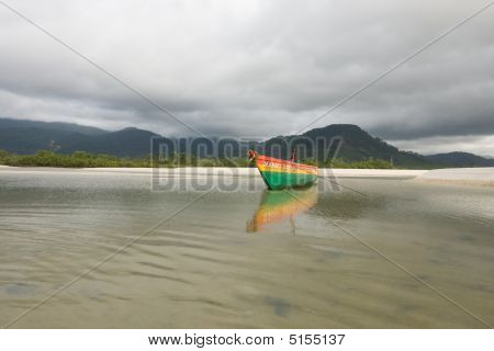 A colorful fishing boat in the bay of number two river beach in Sierra Leone poster