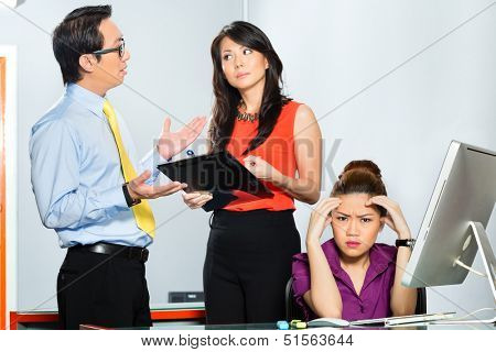 Asian Colleagues or coworker and manager discuss about or bullying or chicane stressed or anger employee with burn out or problems