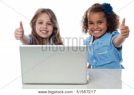 Two Happy Kids Showing Thumbs Up