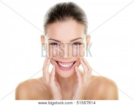 Beautiful Asian beauty woman touching perfect face skin laughing happy. Healthy skincare concept with candid smiling girl smiling at camera. Body care concept. Fresh mixed race Asian Caucasian, 20s.