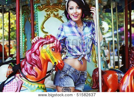 Rejoicing. Merriment. Excited Lively Woman In Funfair Smiling