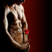 the very muscular handsome sexy guy on black background naked torso poster