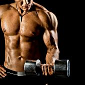 very power athletic guy execute exercise with dumbbells on black background poster