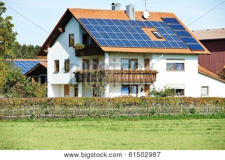 Alternative energy. Solar panels on modern house cottage roof