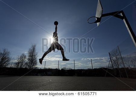 Basketball Player Slam Dunk Silhouette