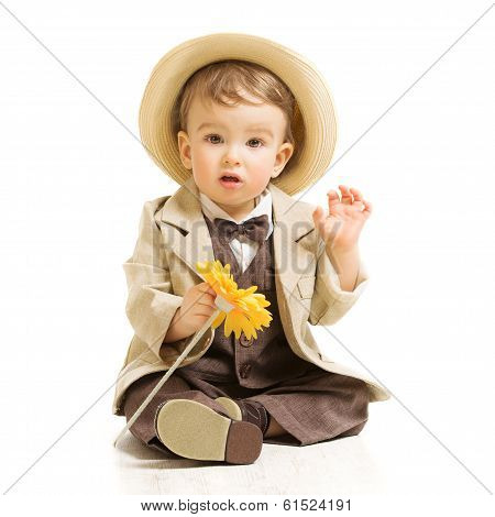 Baby Boy Well Dressed In Suit With Flower. Vintage Children Style, White Background