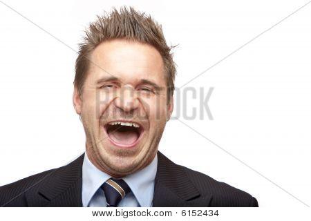 Businessman Laughs Into Camera
