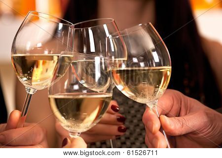 Clicking Glasses With White Wine.