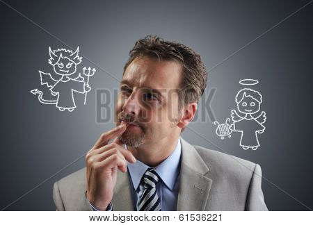 Businessman with chalk drawing angel and devil on his shoulders concept for conscience, decisions, uncertainty or moral dilemma poster