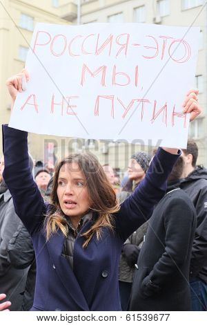 MOSCOW - MARCH 15: Young woman with the poster in a time of a protest manifestation against war in Ukraine, Circular Boulevards in Moscow, Russia on March, 15, 2014.