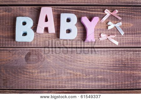 word baby  on wood background