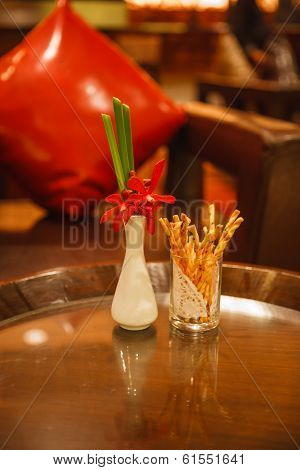 table with snacks and orchid