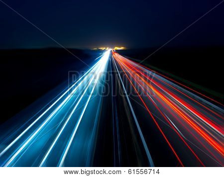 Blurry abstract photo of the lights of cars on the highway poster