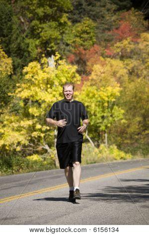 Man Running In Black