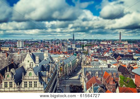 Vintage retro hipster style travel image of aerial view of Ghent from Belfry. Ghent, Belgium with tilt shift toy effect shallow depth of field