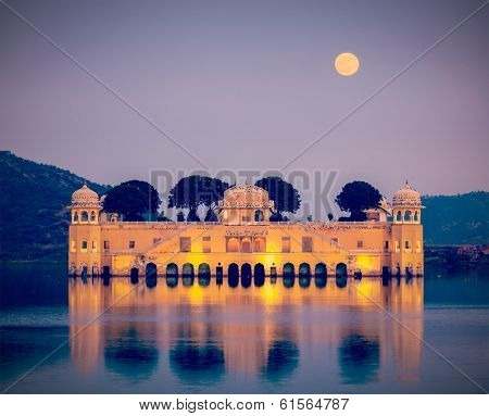 Vintage retro hipster style travel image of Rajasthan landmark - Jal Mahal (Water Palace) on Man Sagar Lake in the evening in twilight.  Jaipur, Rajasthan, India poster