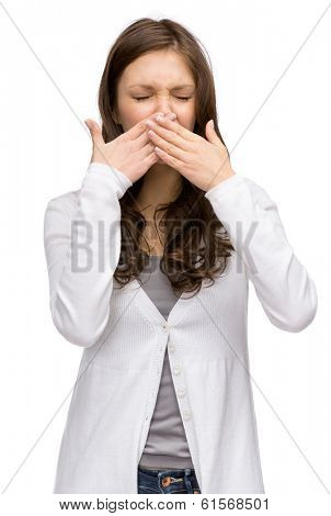 Portrait of woman with closed eyes covering her nose, isolated on white. Concept of stink and disgust