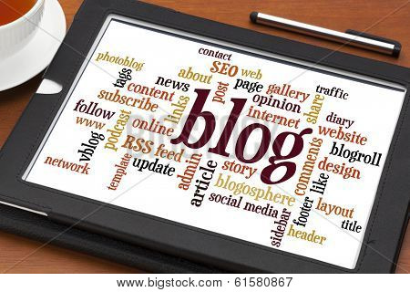 blog word cloud  on a  digital tablet with cup of tea and stylus pen