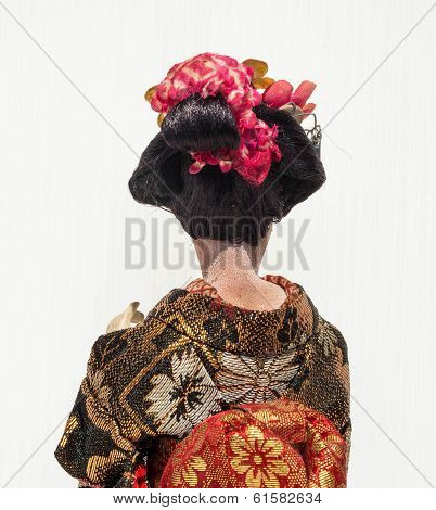 Backside Of Japanese Traditional Doll Of Dancing Geisha With White Background