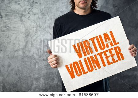 Man Holding Banner With Virtual Volunteer Title