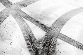 Transportation background with tire tracks on wet snow poster