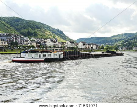 Ship And Cochem Town On Riverbank Of Moselle River