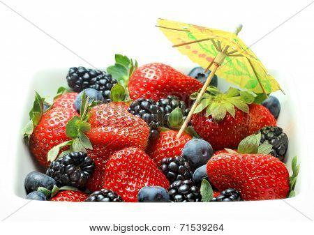 Bowl of fresh strawberries blueberries and blackberries